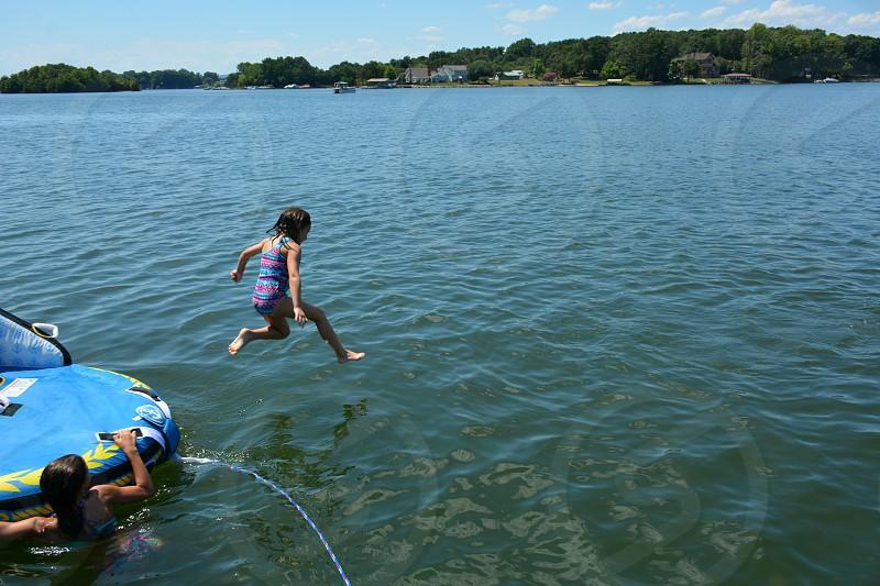 jumping into Lake Norman in Mooresvill North Carolina photo