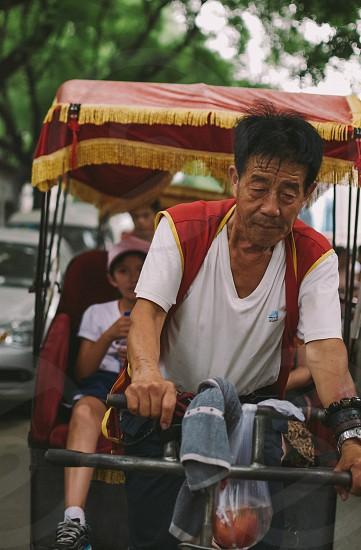 China rickshaw urban city work photo