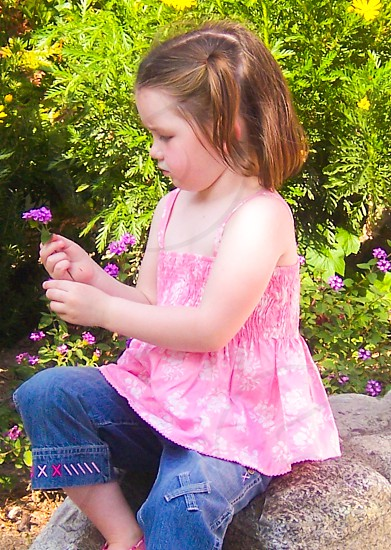 Girl holding a Flower photo