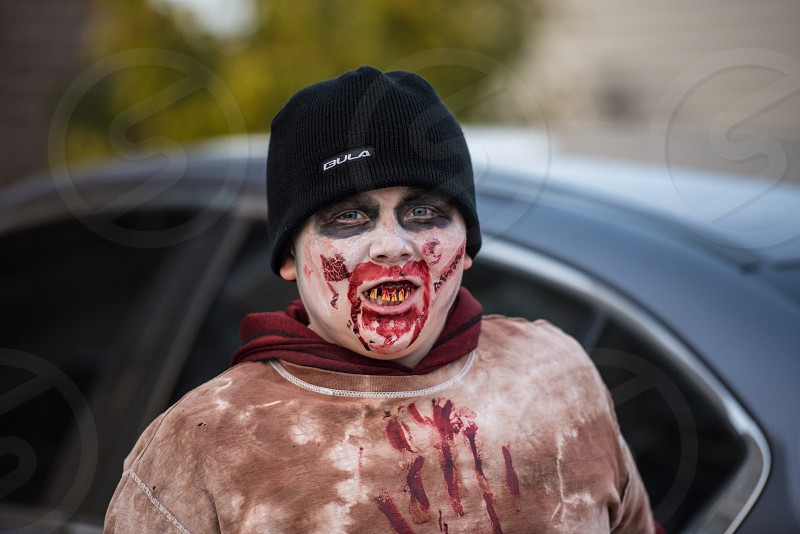 Boy dressed as a zombie on Halloween for Trick or Treat. photo