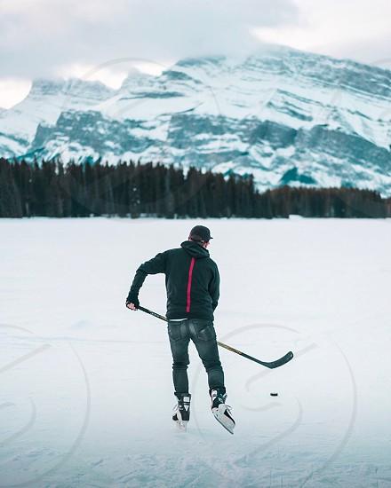 Canada hockey mountain sunrise skate Canadian Alberta two jack lake hoodie skate ice photo