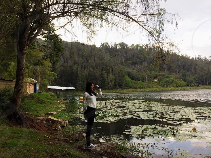 Lake girl meditating green photo