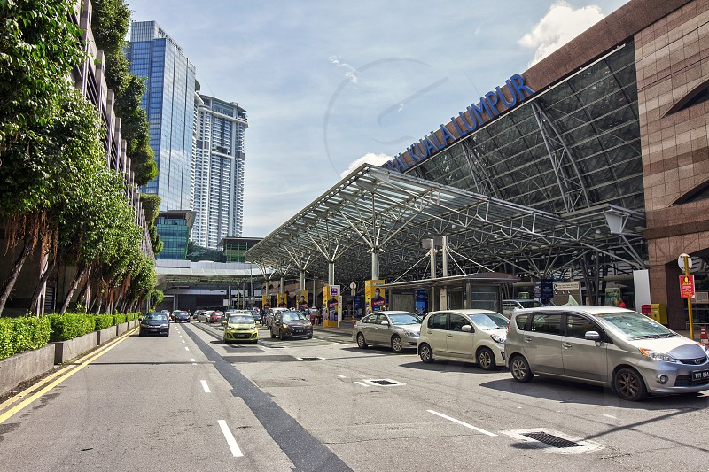 exterior view of kl sentral translating hub in Kuala Lumpur in sunny day congested  with traffic photo