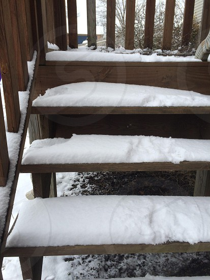 snow covered brown wooden staircase photo