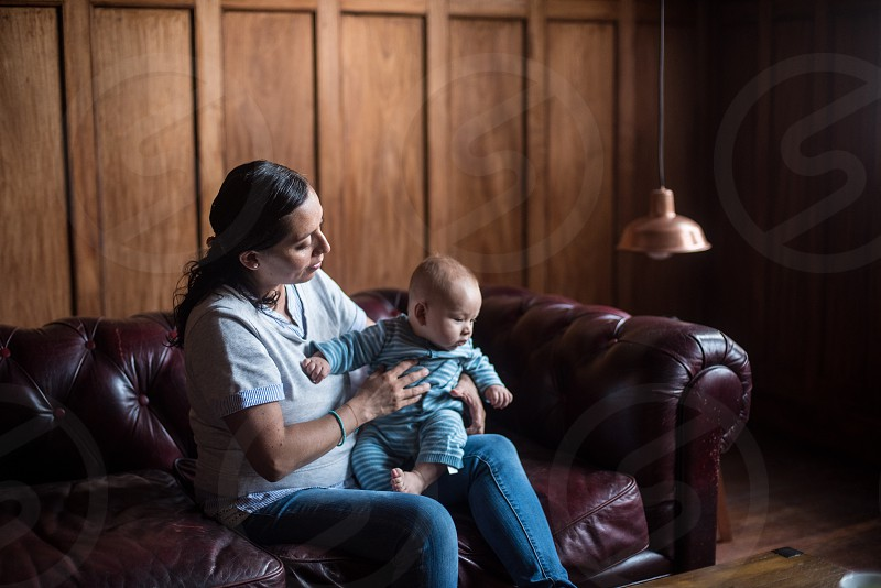 Mexican mother and baby at home photo