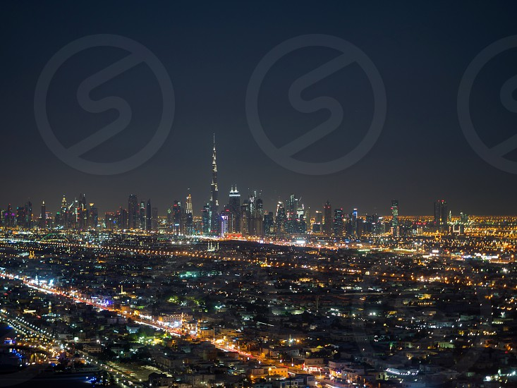 The Dubai city at night with illuminated skyscrapers and buildings photo