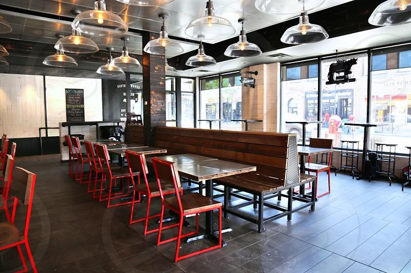 red steel framed chair near white wooden table inside restaurant photo
