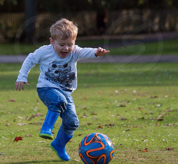 Young boy playing football  photo