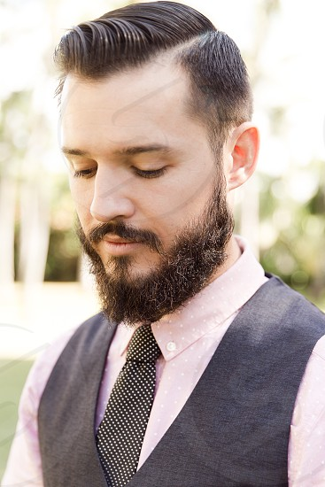man in gray and pink dress suit photo