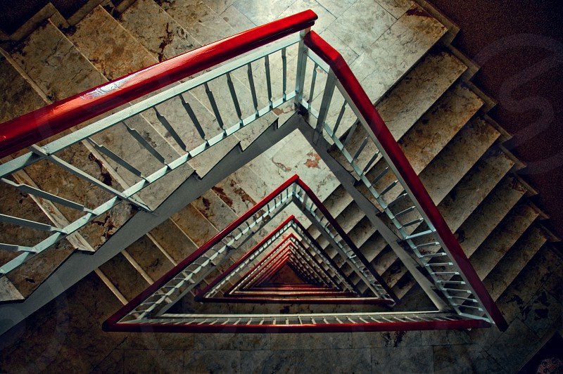A triangular staircase shot from the top down. photo