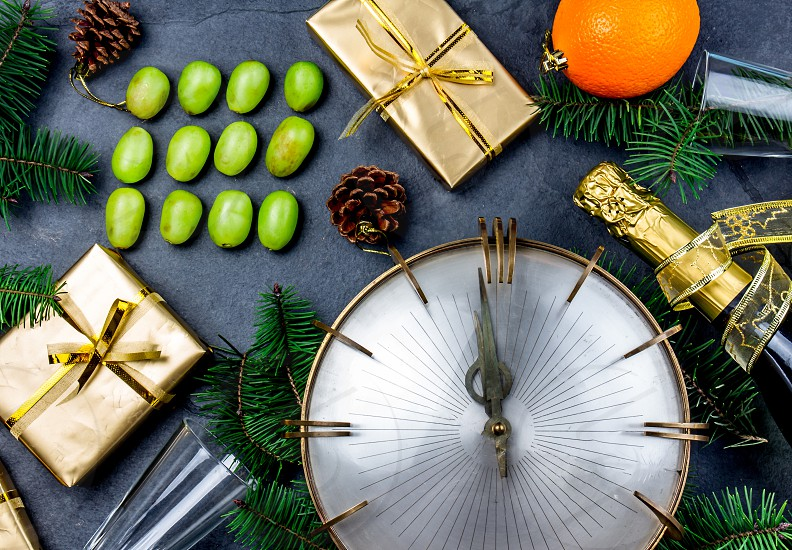 NEW YEAR TRADITION. Latin American and Spanish New Year traditional. Funny ritual to eat twelve 12 grapes for good luck at midnigth. Flat lay top view. Christmas New Year composition photo