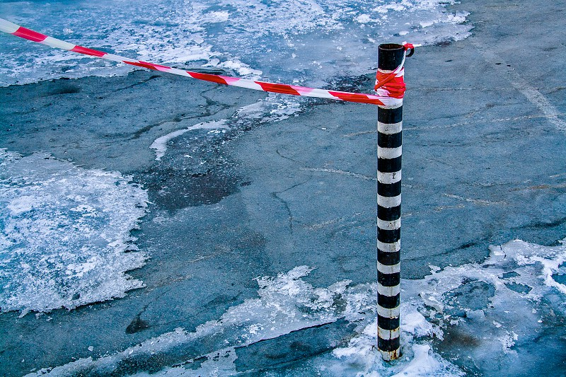 Red-white guard tape on black-white pile photo