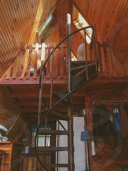brown wooden stair case in bunk house photo