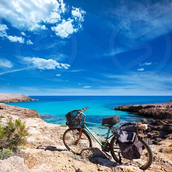 Menorca Cala des Talaier beach with aged grunge bicycle photo
