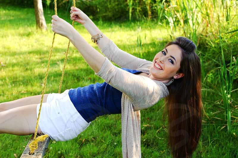 Portrait Female on Swing photo