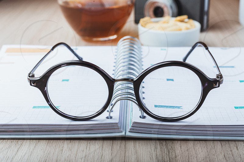 Woman glasses with planner tea and camera photo