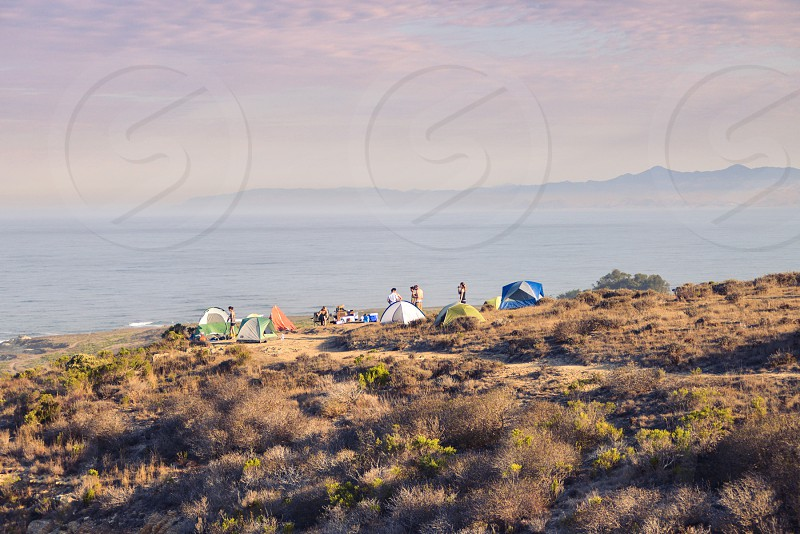 tents campout camping friends morning photo