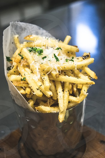 french fries on stainless steel bucket photo