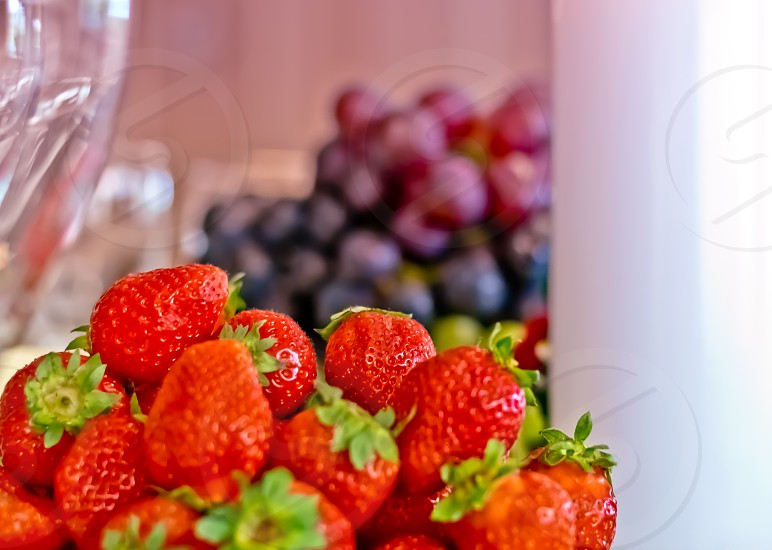 selective focus photography of bunch of strawberries photo