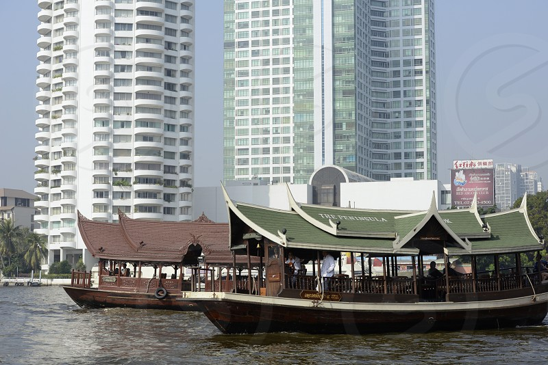 a traditional boat at the Mae Nam Chao Phraya River in the city of Bangkok in Thailand in Southeastasia. photo