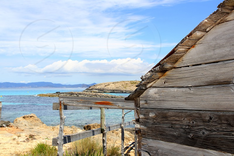 Formentera wooden boat traditional houses  illetes aged weathered photo