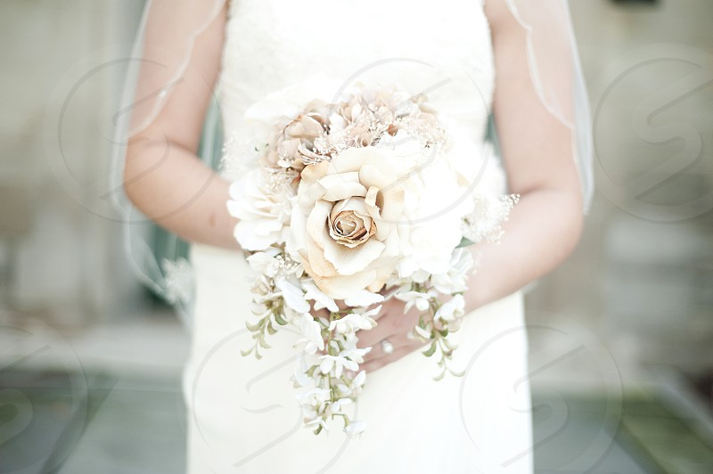 white and ivory bridal bouquet with center white rose photo