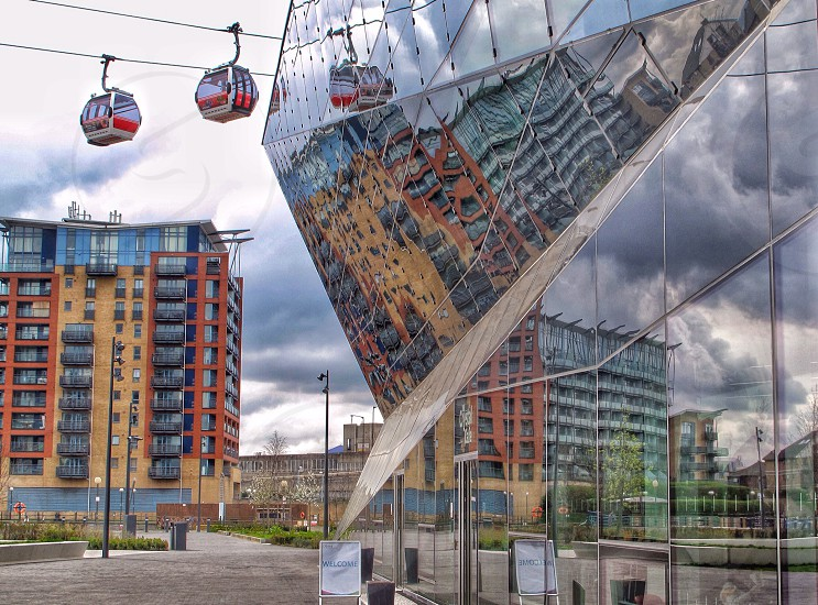 Mirror reflection Siemens cable car london docklands patterns building stormy triangles angles  photo