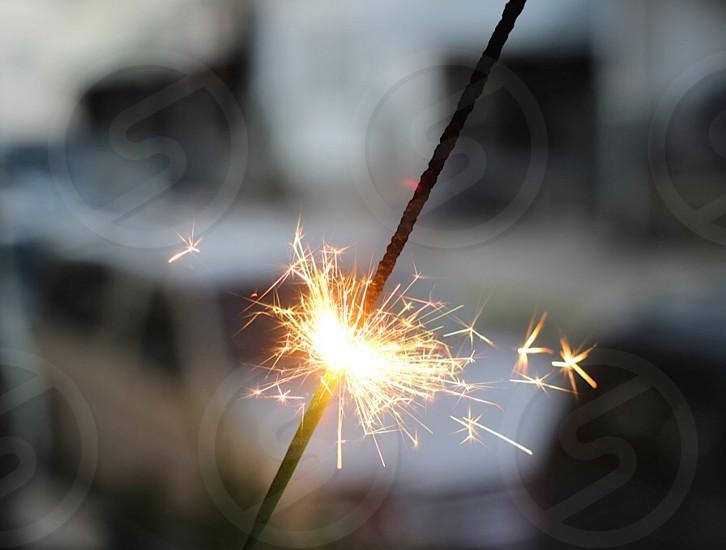 half lighted sparkler during daytime photo