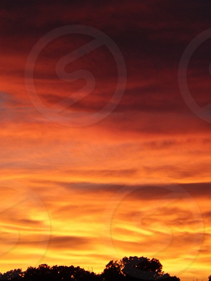 Bands on the Run in a sunset sky filled with clouds photo