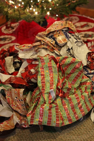 After math Christmas wrap waste. Trash landfill green earth dump reused tree holiday gifts presents photo