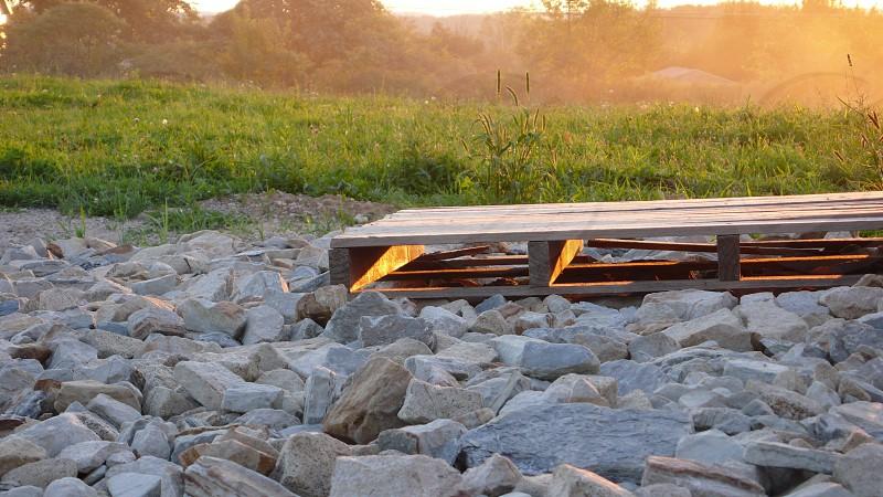 Pallet. Skid. Sunset. Stones. Rocks. photo