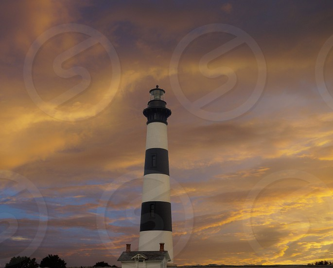 Lighthouse in sunset photo