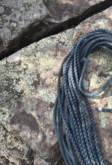 Blue sport climbing rope against lichen covered rock at Taylor's Falls state park in Minnesota. photo