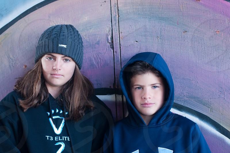 boy in blue hoodie beside woman wearing gray knit cap photo