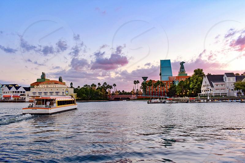 Orlando Florida. February 09 2019 Taxi boat sailing on lake on cloudy sky background at Lake Buena Vista area (7) photo
