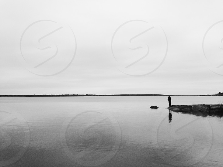 Silhouette black and white lake peaceful isolation reflection photo
