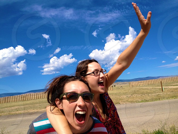 two woman shouting under the sun photo photo