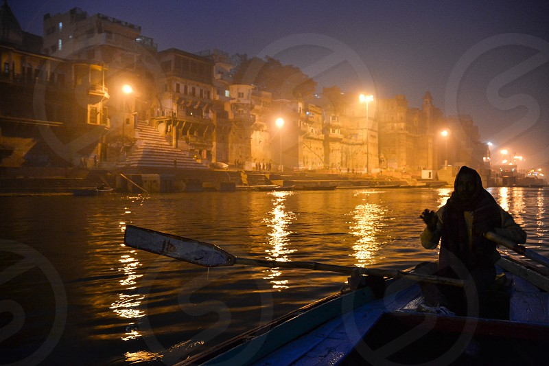 Night boat ride in Varanasi India photo