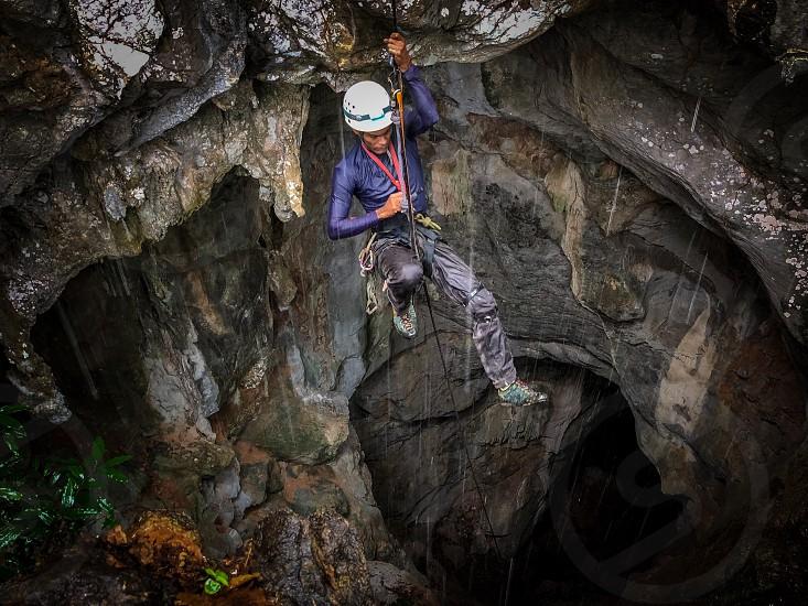 climbers climbing karst limestone perlis malaysia black marlow rope abseiling repelling rock  photo