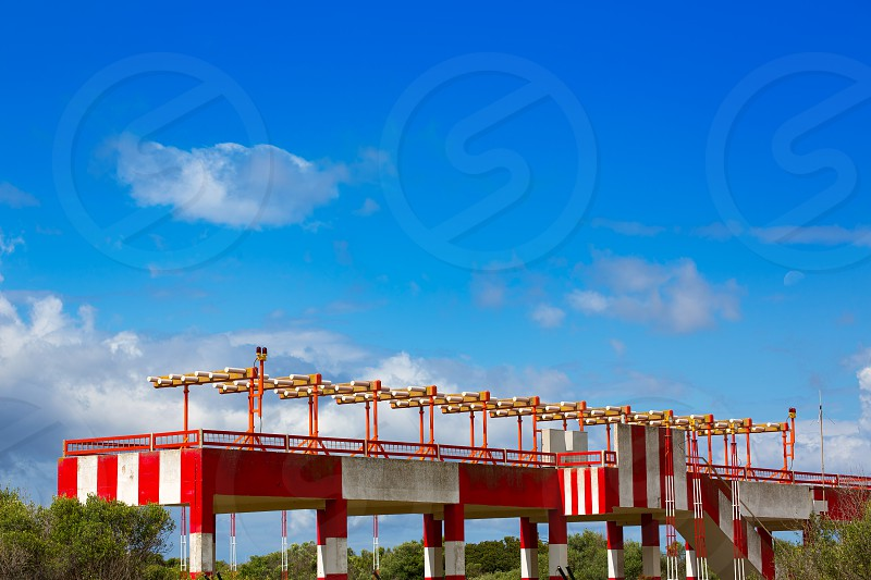 Airport lights for aircraft landing on blue sky photo