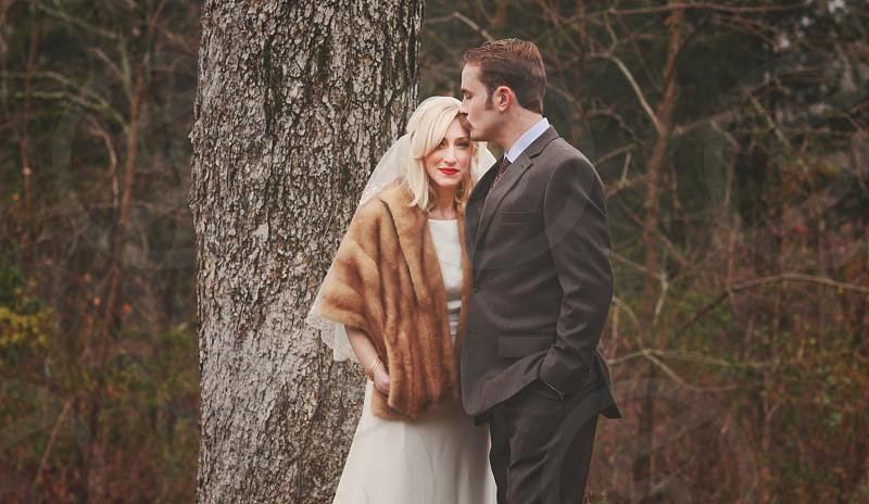 couple wedding outdoor texture trees winter fur coat dressy pale skin photo