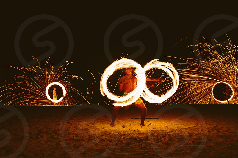 firedancer fire beach entertainment fiji south pacific smoke flame yellow orange night wedding party celebration people activitiy photo