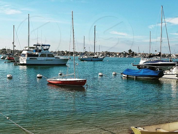 photo of boat near seashore at daytime photo