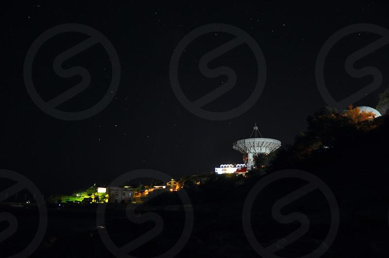 radio telescope aimed at the night sky photo