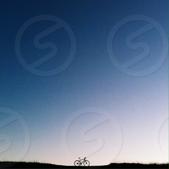 bicycle silhouette and blue sky  photo