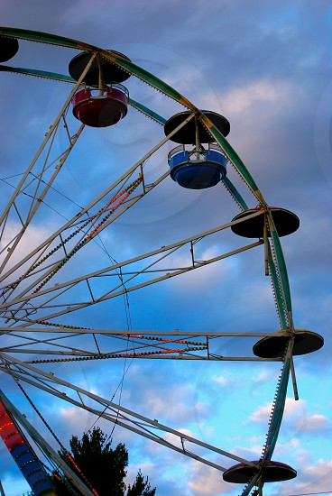 green ferris wheel under white cloudy sky during daytime photo