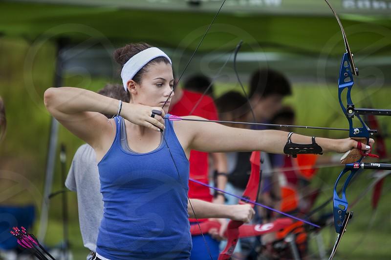 Teenage girl at archery practice photo