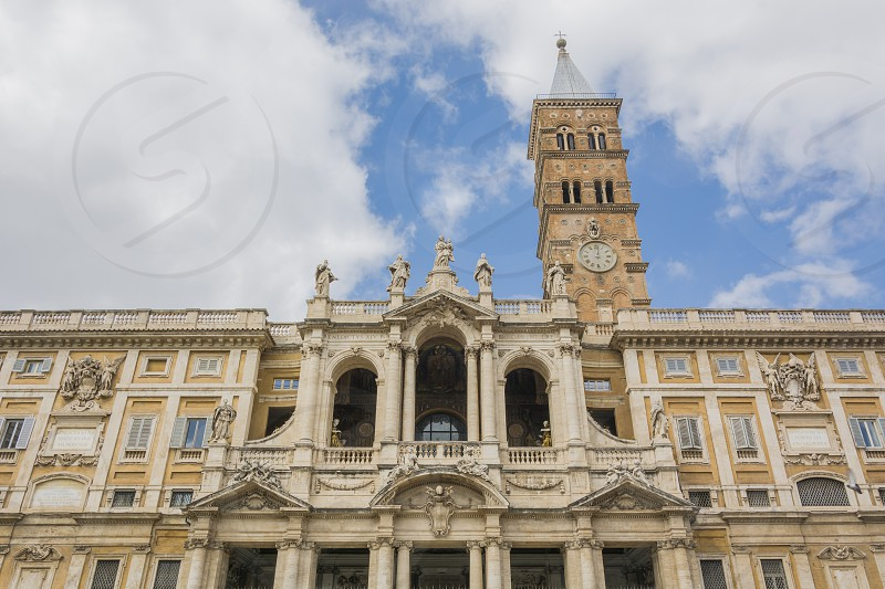 """Facade of the Santa Maria Maggiore Basil in Rome. The Basilica di Santa Maria Maggiore ('Basilica of Saint Mary Major') or church of Santa Maria Maggiore is a Papal major basilica and the largest Catholic Marian church in Rome Italy from which size it receives the appellation """"major"""".  photo"""