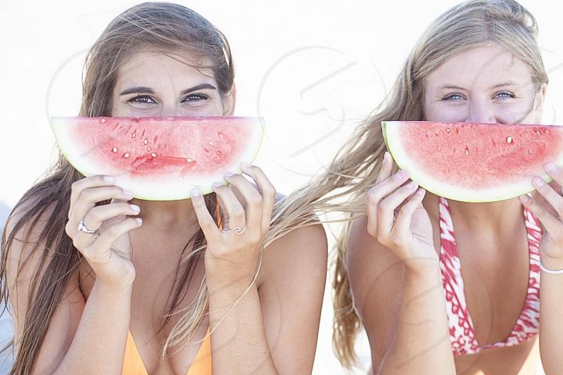 woman holding sliced watermelon photo