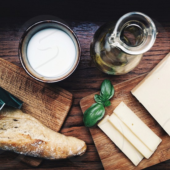 white cheese on wooden board near bread photo